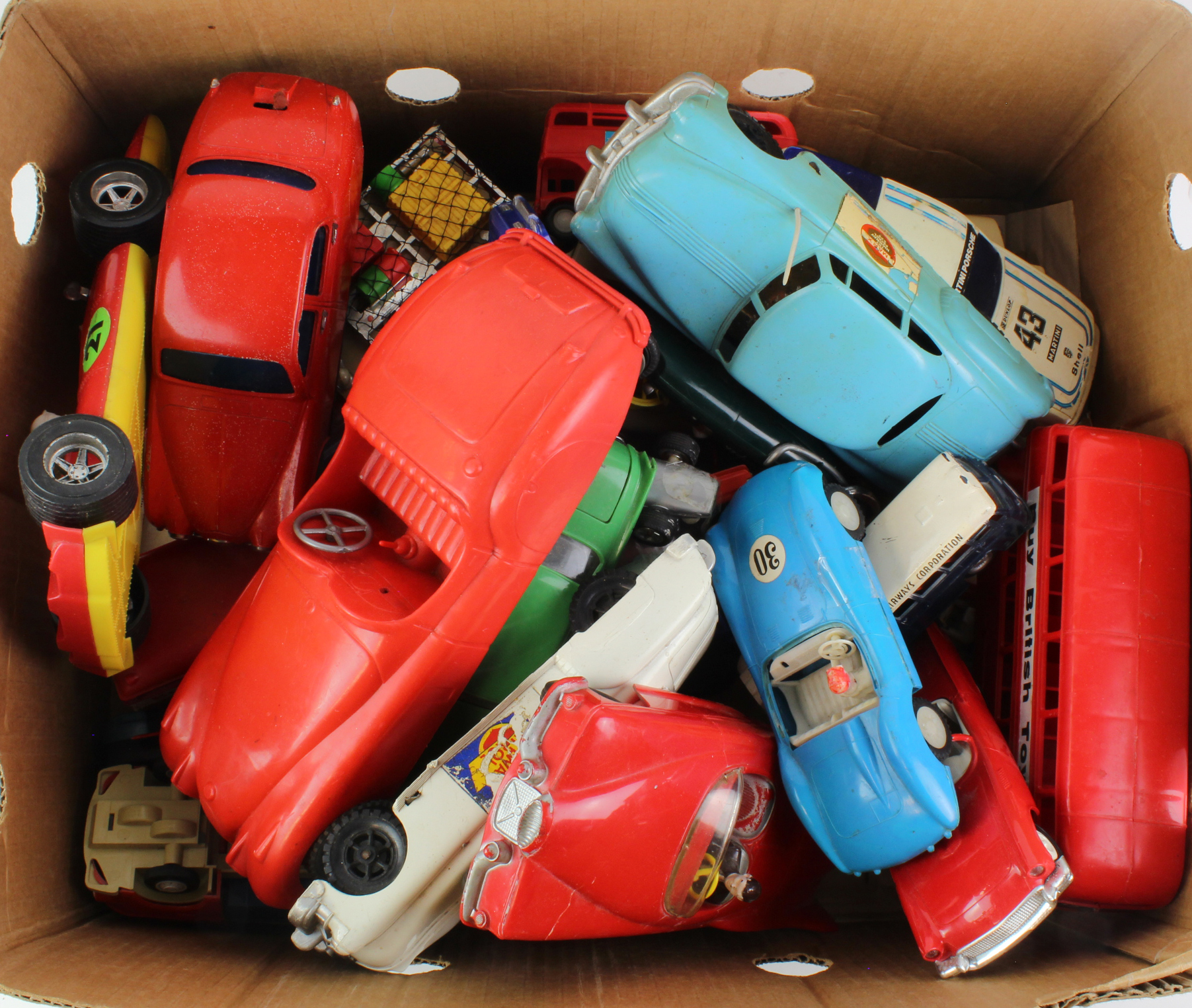 Lot 935 - Toys. A collection of moulded plastic toy cars, circa mid 20th Century, makers include Marx, Hoda,