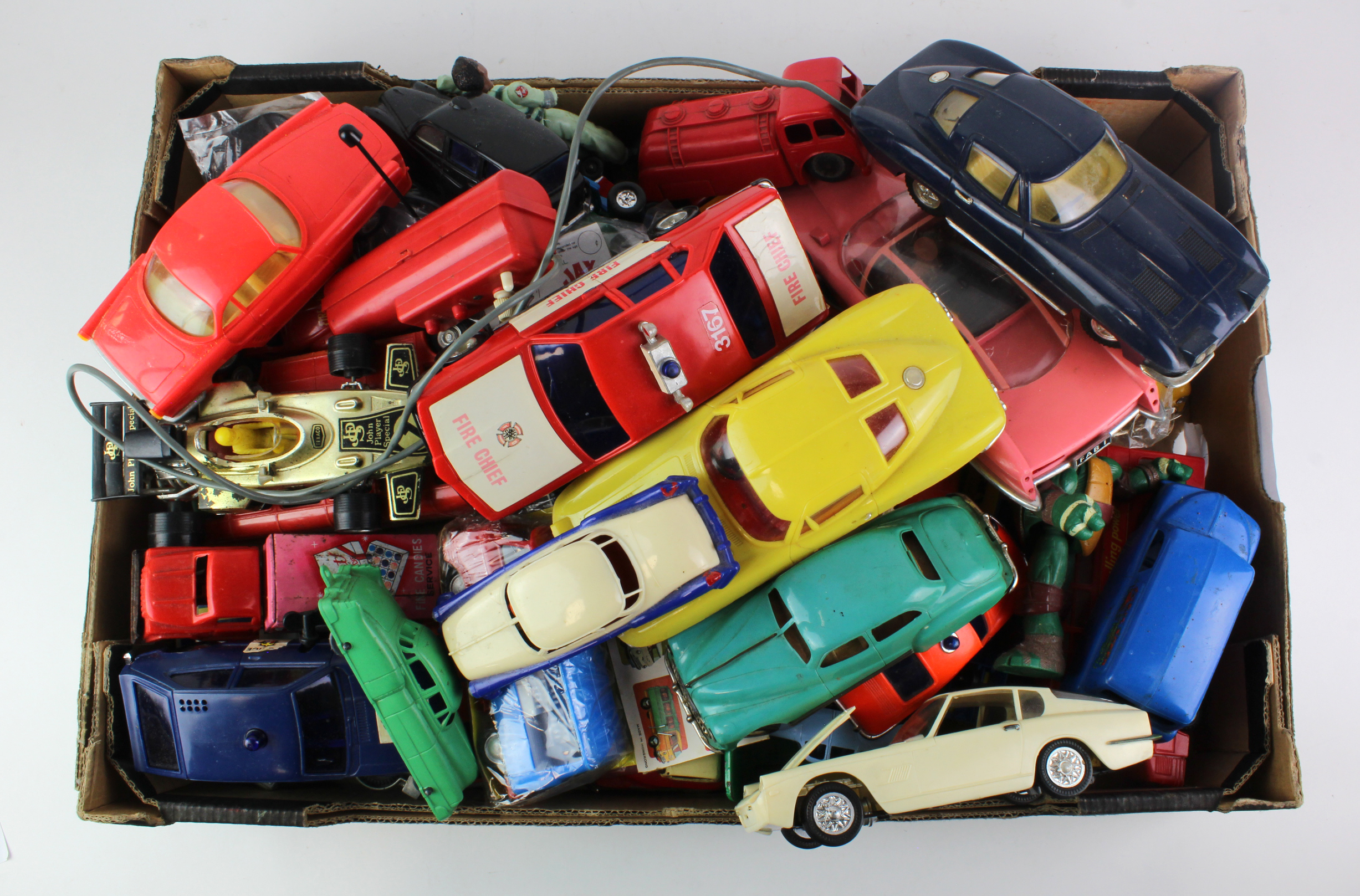 Lot 936 - Toys. A collection of moulded plastic toy cars, circa mid 20th Century, makers include Marx,