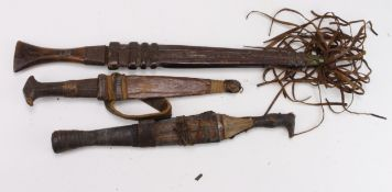African Tribal knives, leaf shaped blades, leather scabbards, surface rust to blades. Nice lot worth