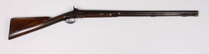 19th Century percussion cap rifle by a Saxmundham gun maker. Ramrod fitting bar loose. Sold as seen
