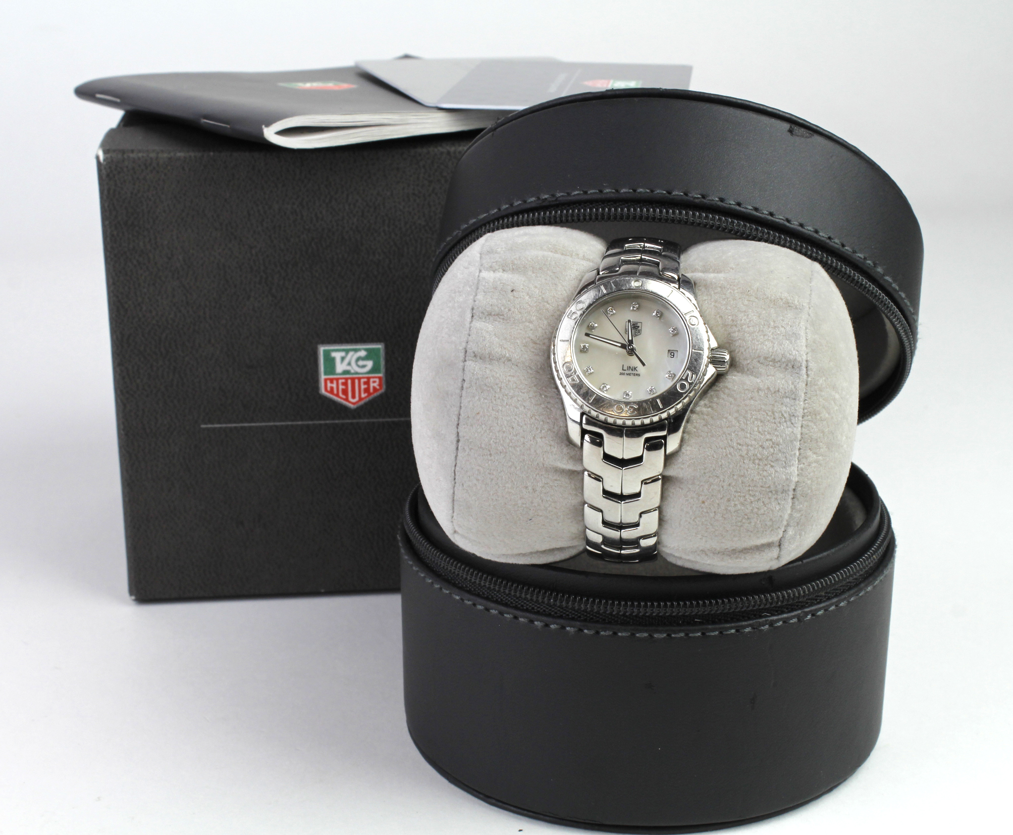 Ladies stainless steel Tag Heuer link bracelet watch, having signed mother of pearl dial with