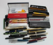 Pens & Pencils. A collection of over thirty fountain pens, ballpoint pens, pencils etc., makers