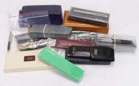 Pens & Pencils. A collection of twenty-eight fountain pens, ballpoint pens, pencils, etc., makers