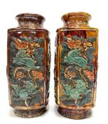 A pair of Chinese treacle glazed relief moulded vases, painted and gilded and in square section