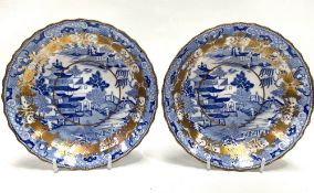 A pair of early 19th century Coalport blue and white transfer printed shallow bowls decorated with