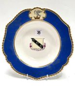 A 19th century Chamberlains Worcester armorial shallow bowl with blue ground, the central armorial