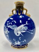 A Victorian Mintons pate-sur-pate moon flask decorated with a stork in flight amongst prunus blossom