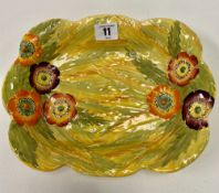 A Carlton Ware poppy flowerhead and leaf moulded painted dish with yellow ground, stamped No. 326,