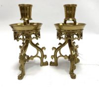 A god pair of 19th century brass Gothic influence candlesticks attributed to Adolf Frankau & Co,