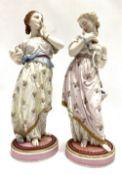 A pair of 19th century Paris Vinonet & Baurey painted bisque porcelain lady figures, both holding