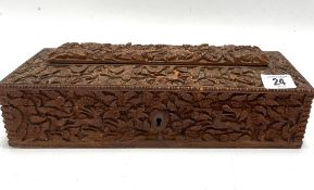 An Indian carved teak rectangular hinge lidded stationery box, with caddy top, the whole profusely