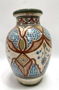 A large Persian ovoid tin glazed earthenware vase, signed to the base, height 30cm.