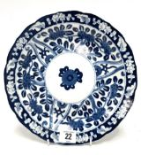 A Chinese blue and white shallow bowl with serpentine edge, decorated with trees issuing blossom,