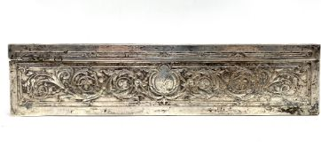 A French silver plate on copper rectangular hinge lidded box, the lid embossed with Mozart playing