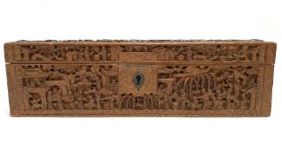 A 19th century Cantonese carved wood rectangular hinge lidded box, profusely carved all over with