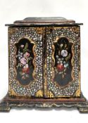 A Victorian black lacquer abalone inlaid painted and gilded jewellery cabinet, the hinged caddy