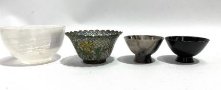Two turned hardstone bowls, the largest diameter 8.5cm, together with an applique jour bowl (3).
