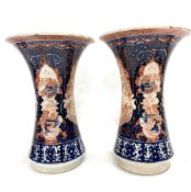 A pair of Chinese Imari flared vases decorated with panels of dragons, Ho Ho birds and pagoda