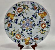 An 18th century English Delft dish decorated with floral sprays, diameter 33.5cm (AF).