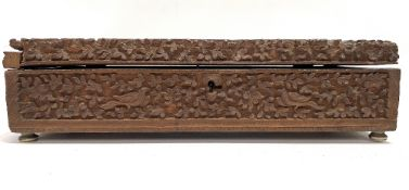 A late 19th century Anglo Indian carved hinge lidded box, the lid carved with a seated gentleman and
