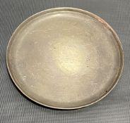 Continental white metal circular card tray, raised on three ball feet, indistinct marks, diameter