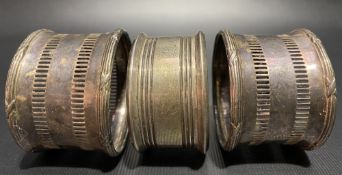 Pair of silver pierced napkin rings; together with one other napkin ring (3), weight 1.95oz approx.