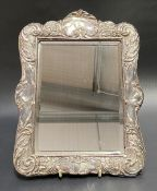 Edwardian silver mounted rectangular bevel edged mirror, the mount with foliate scrolls,