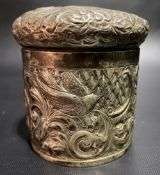 Victorian silver cylindrical lidded box, foliate scroll embossed and with a bird and serpent,
