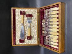 Edwardian oak canteen of silver ivory handled fish knife and fork set for twelve, including slice