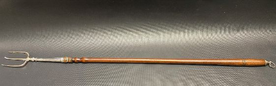 George III silver toasting fork with long turned wood handle and with silver finial with loop,