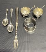 Pair of small Victorian silver circular salts with shaped rims and on triple ball feet, maker JNL,