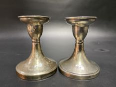 Pair of silver squat candlesticks with engraved dedication, maker S.B & S.L.LD, Birmingham 1931,