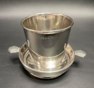 A George V silver cup and stand, retailed by J.C. Vickery, 145/147 Regents St London W.1., the cup