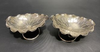 Pair of Chinese white metal lotus leaf shaped oval lobed bonbon dishes by Wang Hing upon wire