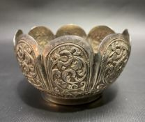 An Indian white metal lobed foliate embossed bowl, diameter 9cm, weight 102g approximately.