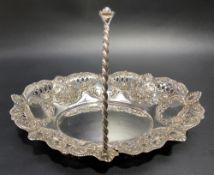 Victorian silver swing handled basket with foliate scroll embossed and pierced decoration and with