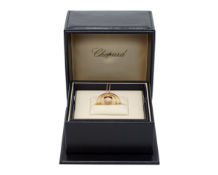 A Lady's Chopard 18K Rose Gold , Happy Diamonds pendant