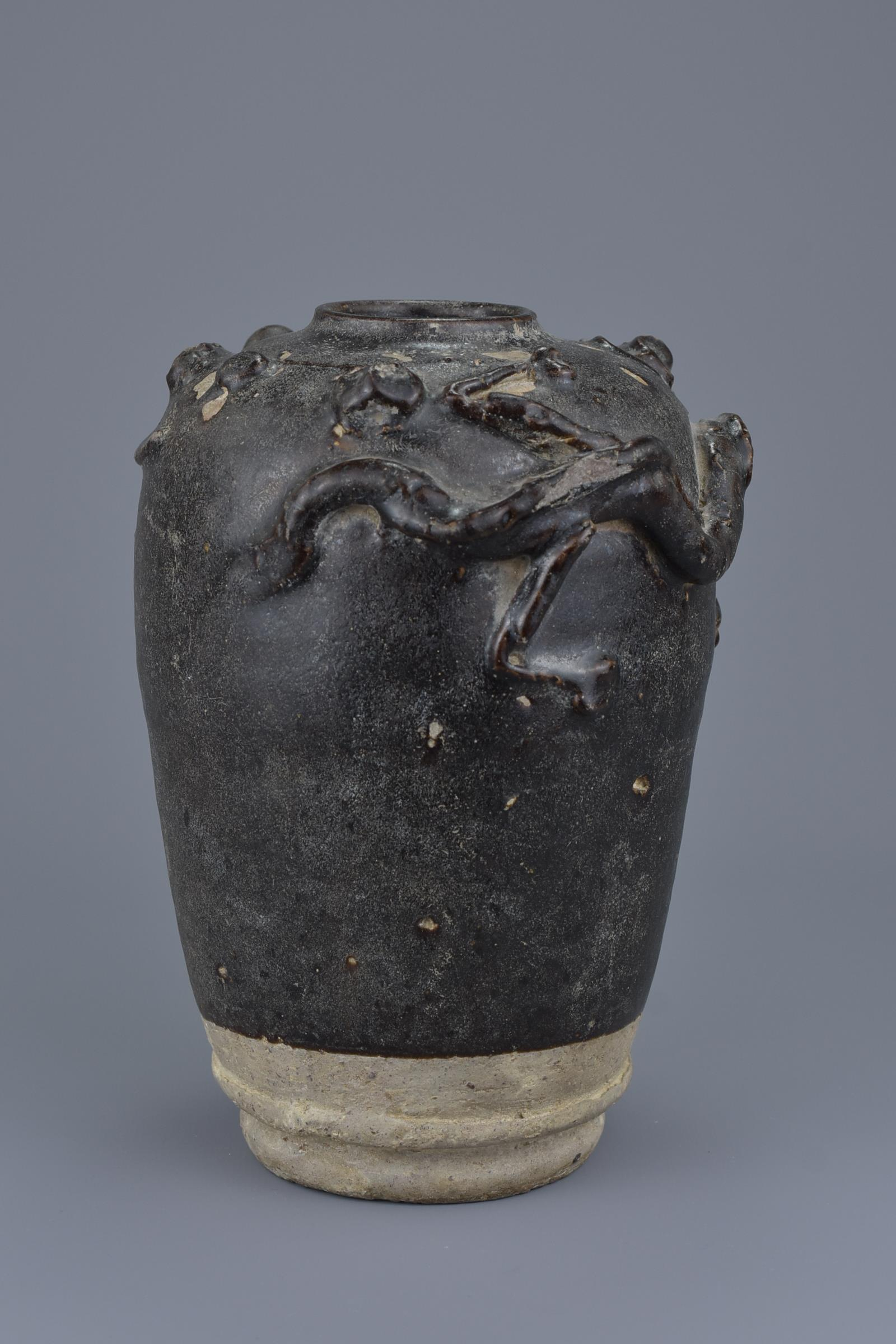 Lot 17 - A Chinese Song Dynasty Stoneware Jar with Dragon Chasing Pearl