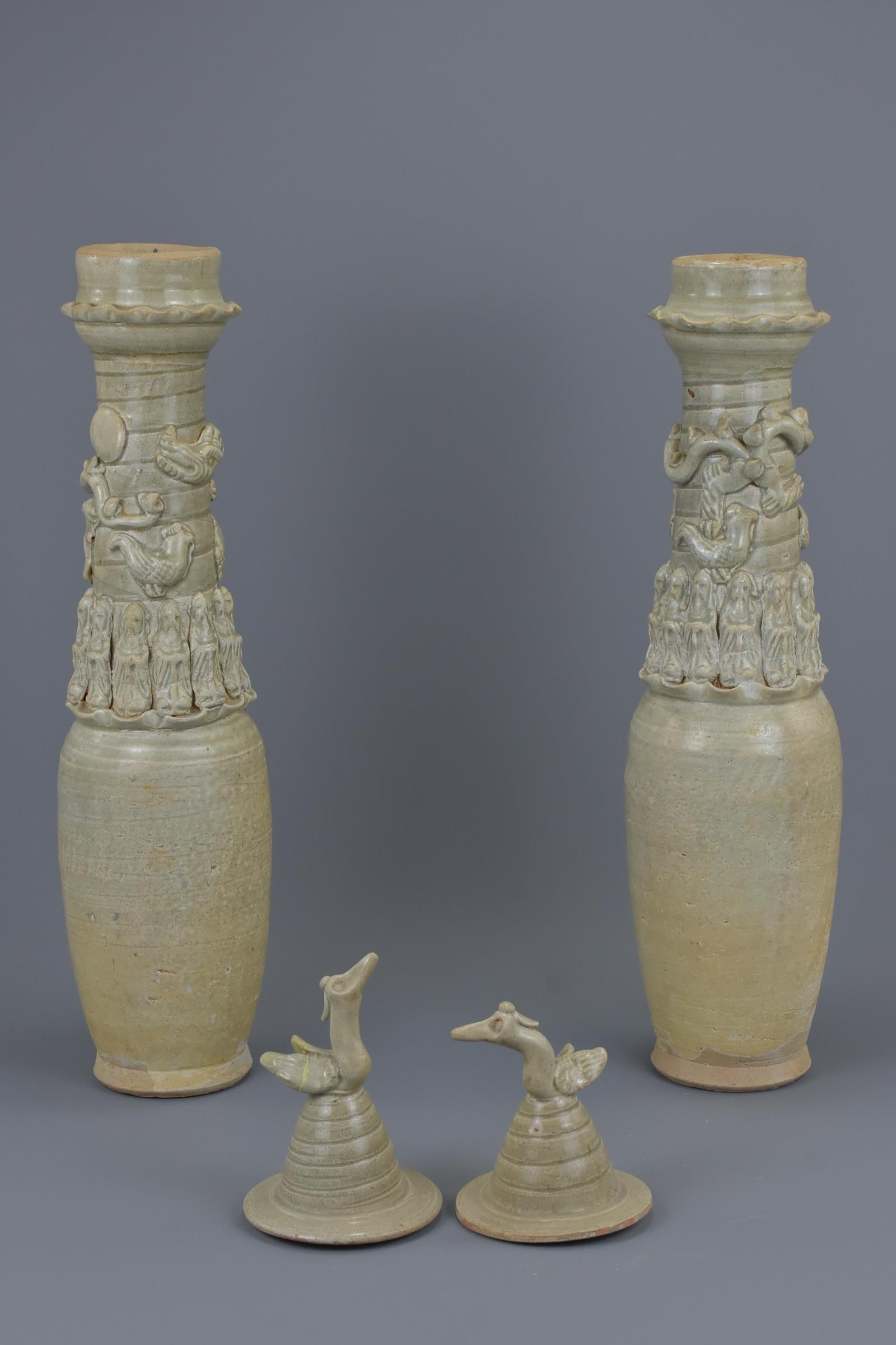 Lot 32 - A Pair of Tall Chinese Song Dynasty Qingbai Porcelain Dragon Vases