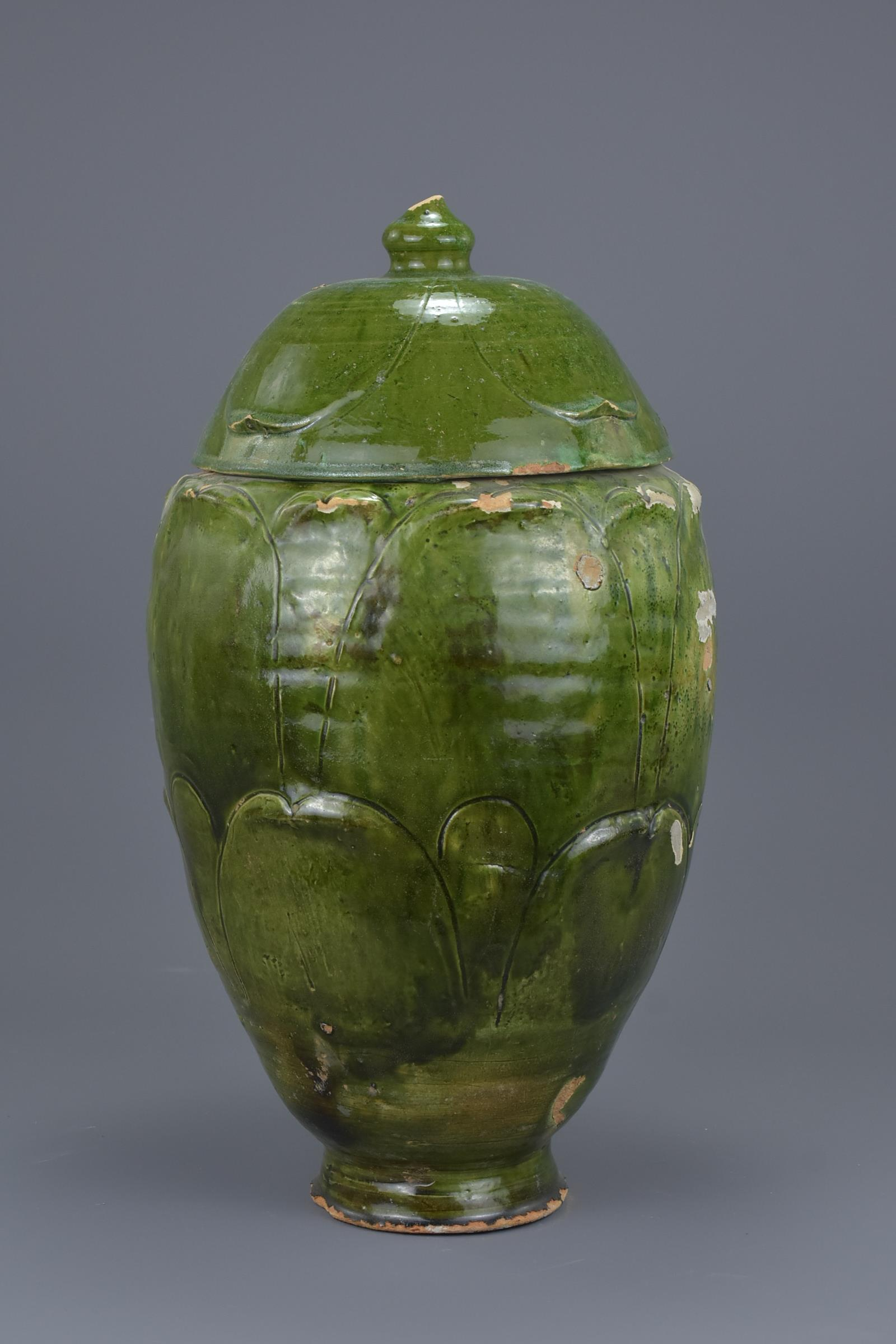Lot 33 - A Rare Large Chinese Song / Yuan Dynasty Glazed Buddhist Jar