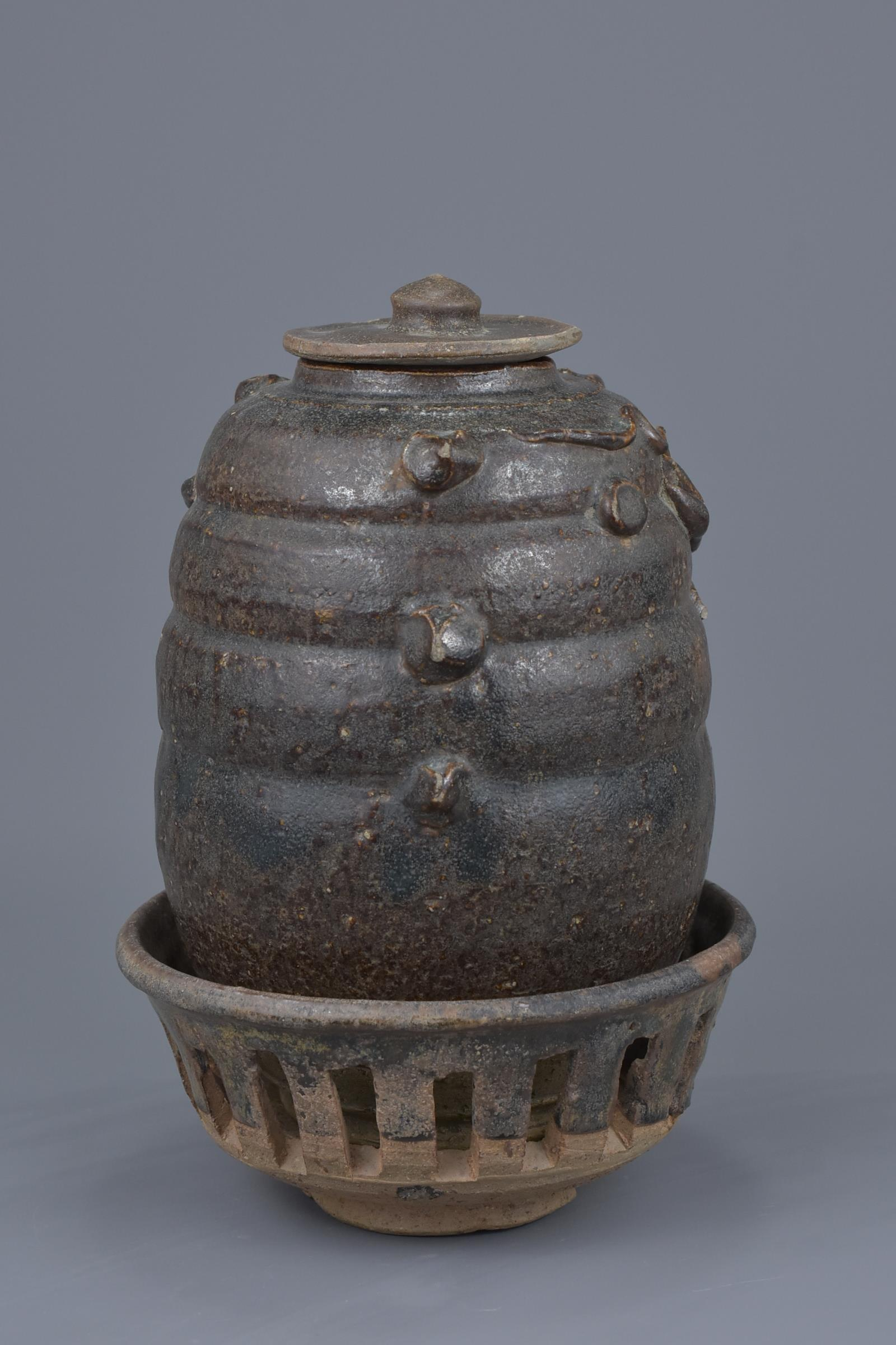 Lot 14 - A Rare Chinese Song Dynasty Dragon Jar with Stand & Cover