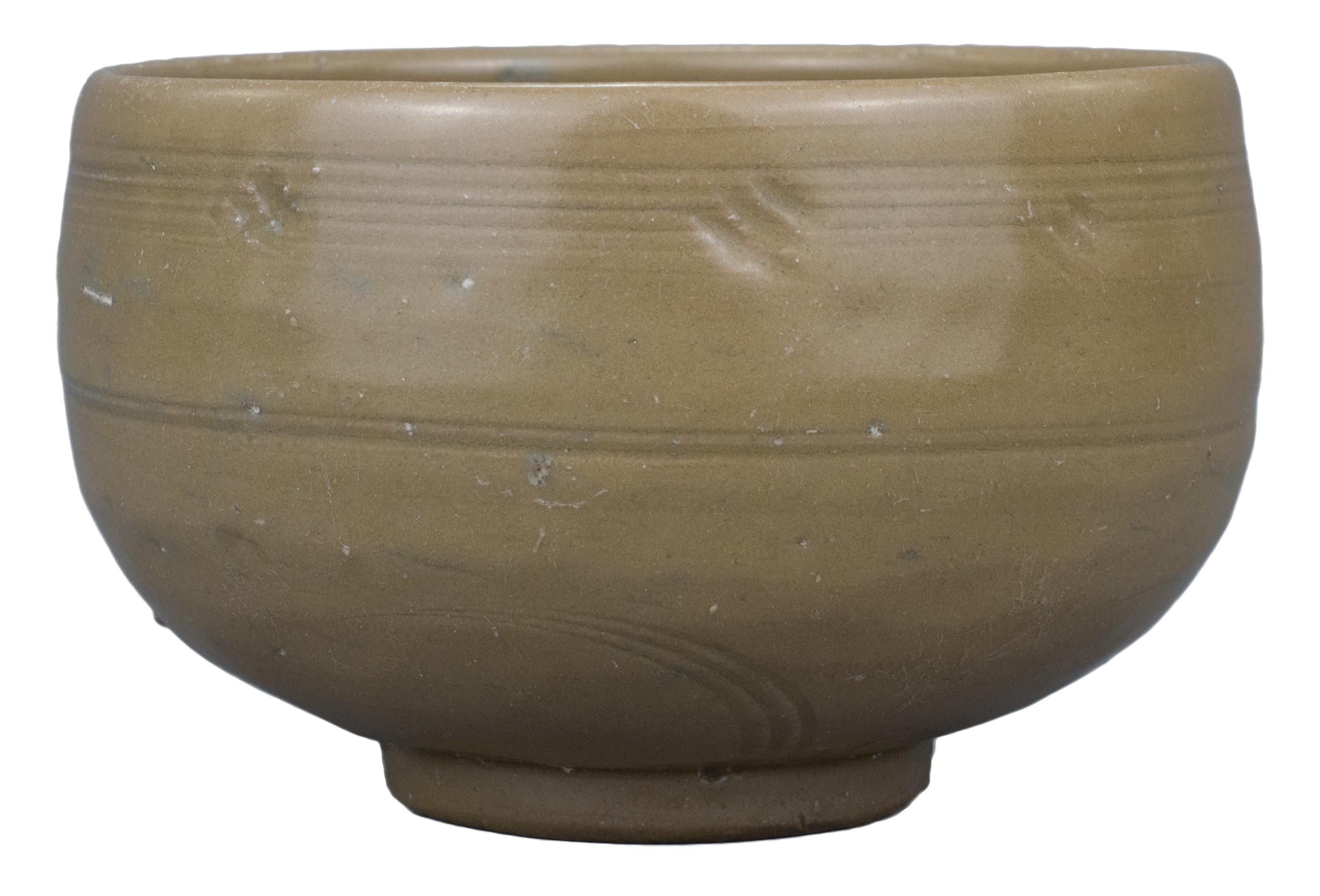 "Lot 21 - A Chinese Longquan ""Golden"" Celadon Porcelain Alms Bowl – Song / Yuan Dynasty"
