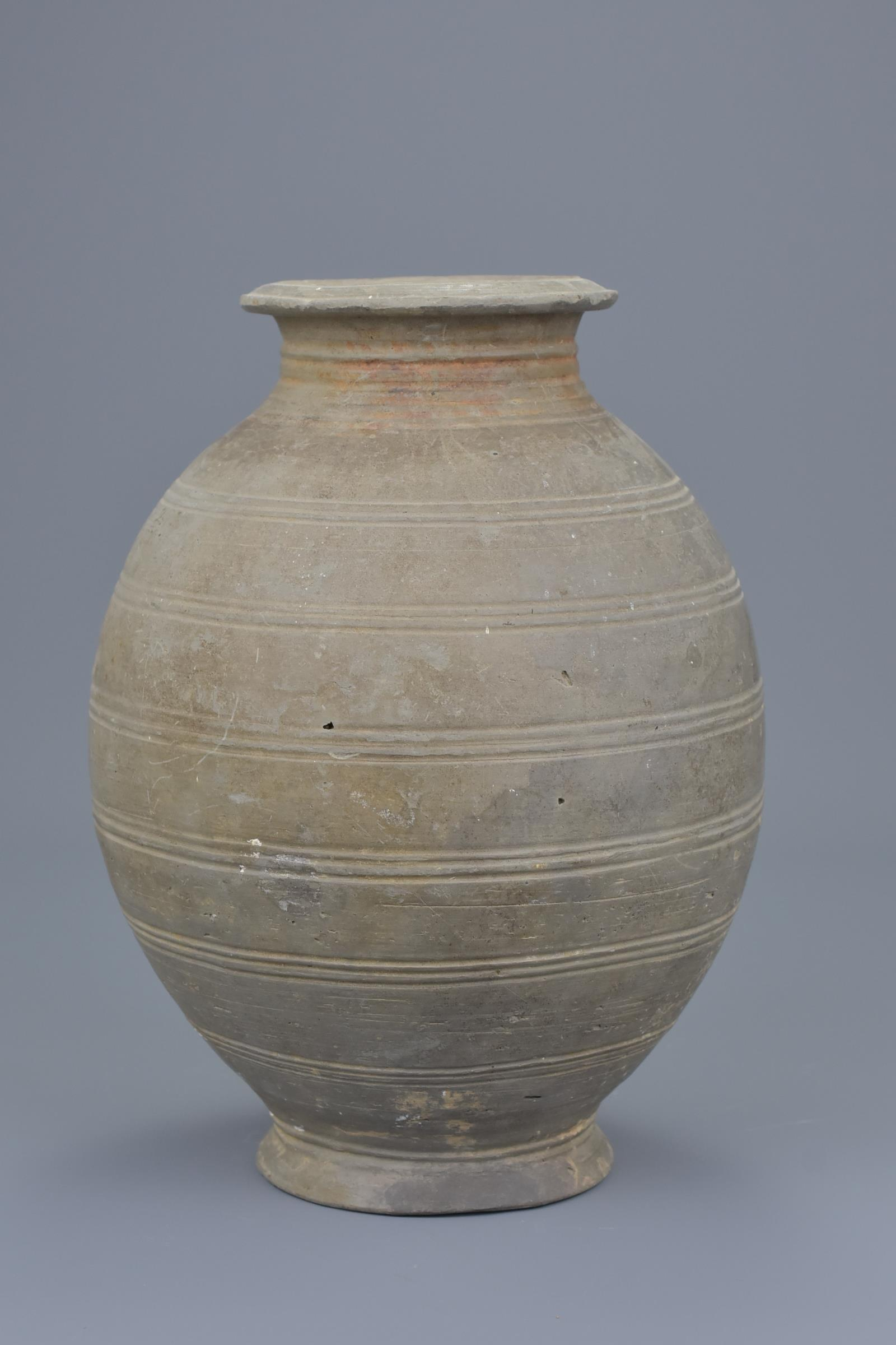 Lot 56 - A Rare Chinese Western Han Dynasty Incised Pottery Jar