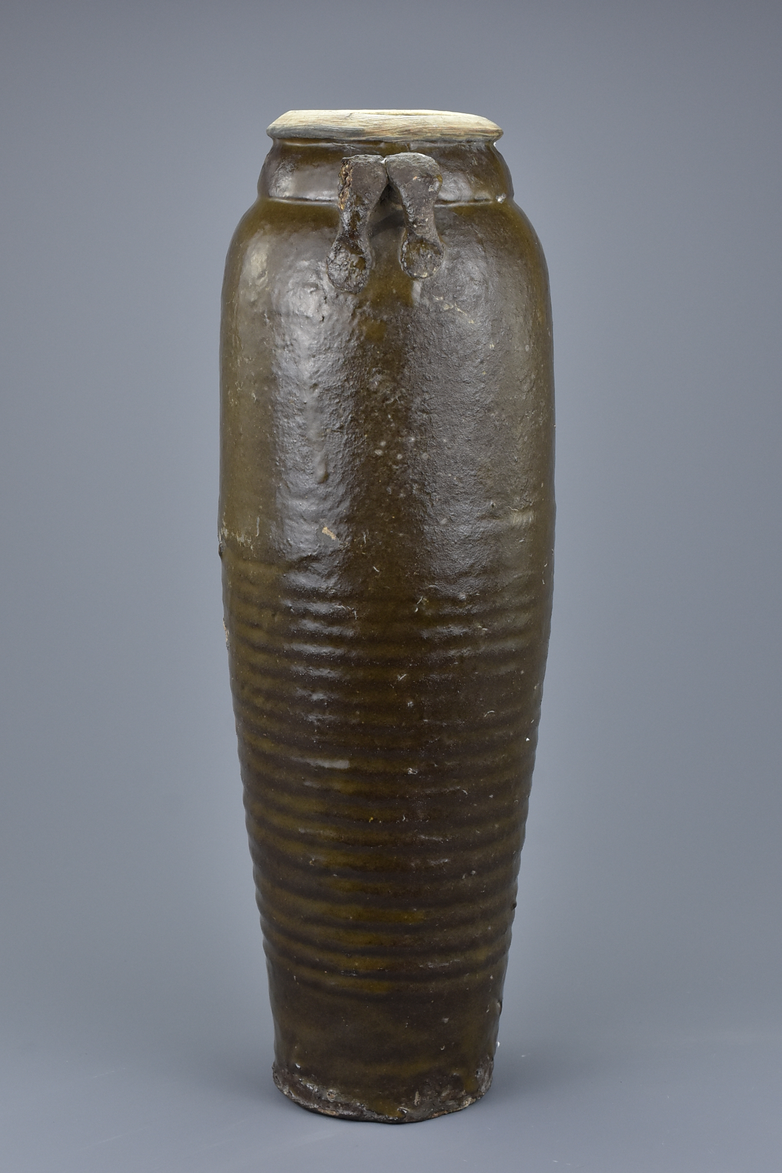 Lot 31 - A Rare Tall Chinese Northern Song or Liao Dynasty Glazed Stoneware Bottle