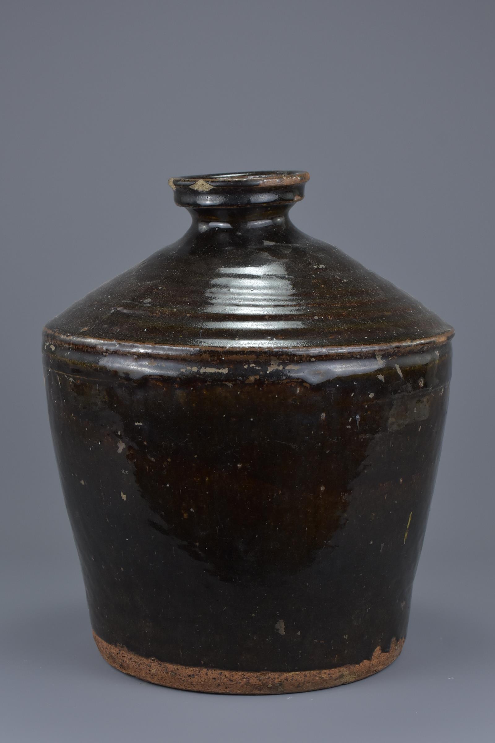 Lot 12 - A Chinese Yuan / Ming Dynasty Henan Glazed Stoneware Jar