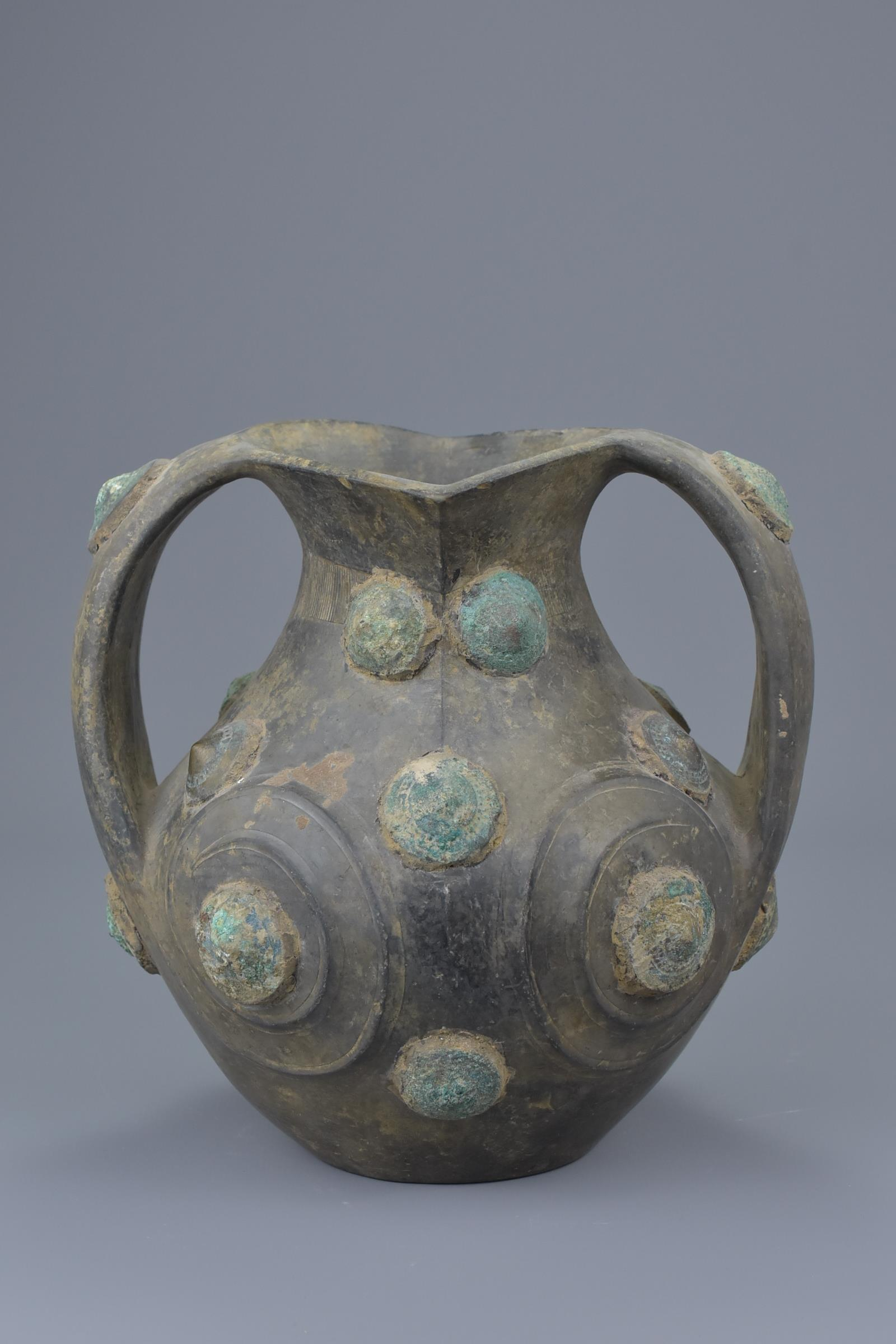 Lot 52 - A Chinese Han Dynasty Black Pottery Amphora with Bronze Appliqués