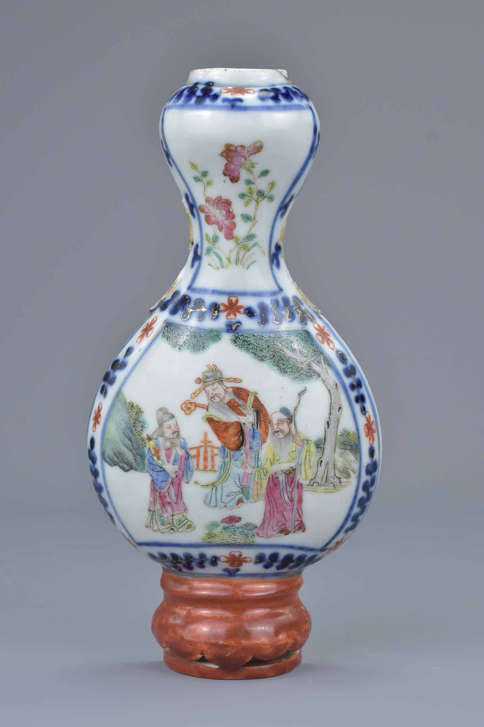 Lot 31 - A Chinese 19th C. Famille rose porcelain wall vase decorated with figures