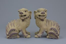 A pair of Chinese 19/20th C. Shiwan pottery dogs