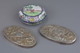 Two Chinese silver brush tops with embossed dragon decoration