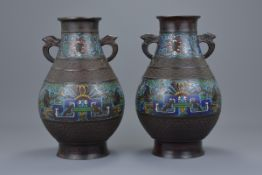 A pair of Japanese 19/20th C. Champlevé bronze enamel vases